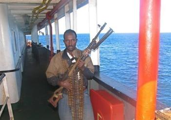 "A Somali pirate poses for his ""wanted"" poster"