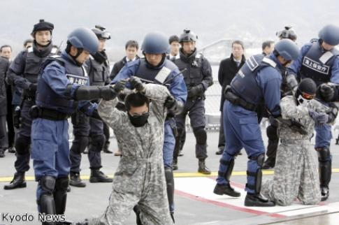 Japanese Maritime Self-Defence Force personnel engaged in an anti-piracy exercise prior to sailing for the Horn of Africa last year.  Or are they just arresting these guys for wearing dodgy camouflage?  ;-)