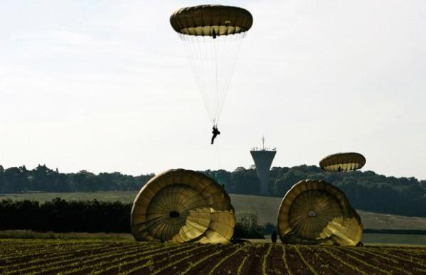 Paratroopers from the 3rd Parachute Battailon land in a wheat field outside the village of Ranville