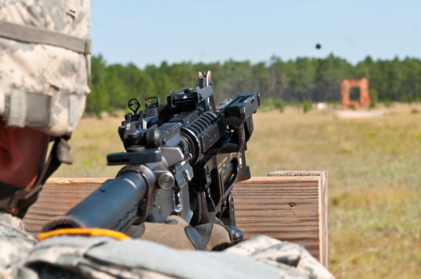 A Paratrooper with 1st Brigade Combat Team, 82nd Airborne Division, fires a training round from the new M320 grenade launcher on a Fort Bragg, N.C., range July 1, 2009. (U.S. Army photo by Spc. Michael J. MacLeod) (Released)
