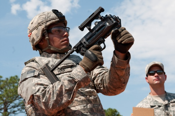 A Paratrooper with 1st Brigade Combat Team, 82nd Airborne Division, fires a training round from the new M320 grenade launcher in its standalone configuration. (U.S. Army photo by Spc. Michael J. MacLeod) (Released)