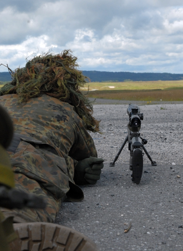 A Special Forces Soldier looks out to the horizon while participating in a Judging Distance (JD) exercise. When judging distance, students in the course have 60-seconds to identify the target and determine the correct distance.