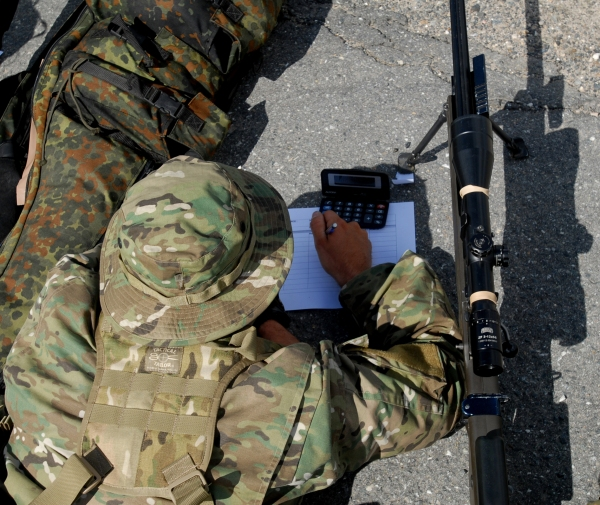 A Special Forces (SF) Soldier writes down coordinates to a target during a Judging Distance (JD) exercise during the International Special Training Centre's (ISTC) Sniper Course at the Grafenwoehr Training Area July 24. Ten high-speed troops from the United States, Germany, Greece and Turkey were evaluated in judging distances, stalking, observing and shooting.