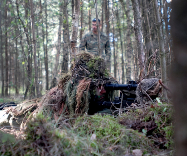A German Special Forces (SF) Soldier lines his sites on a target 500 meters away, and awaits direction from an International Special Training Centre (ISTC) instructor to engage the target. The German Soldier was one of 10 SF troops from four different countries attending the sniper training course offered by the ISTC.