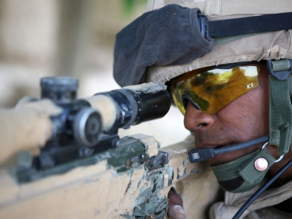 Private Ponipate Boa observes through the scope of his sniper rifle.