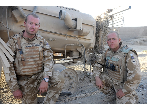 Lieutenant (Lt) Alex Wilson, 29 from Berkshire and Private (Pte) Billy Eden, 22 from Grimsby both pose by their Mastiff vehicle damaged by the IED.  PHOTOGRAPHER: Corporal Mike O'Neill RLC (Phot).