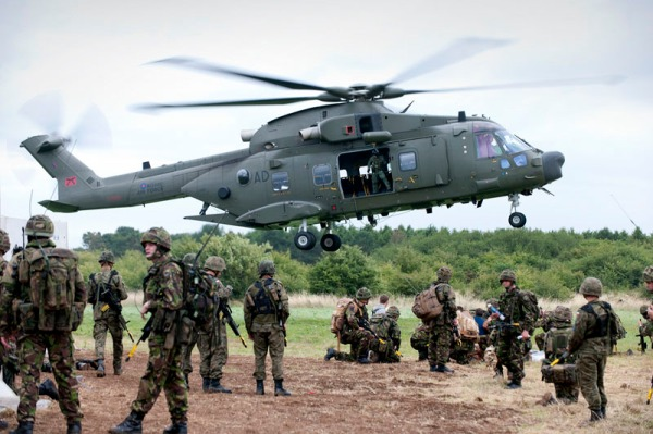 An RAF Merlin Mk 3a Helicopter prepares to embark Troops from 1st Battalion, The Coldstream Guards, during Operation JANUB AGHZAI, during 11 Light Brigade's Mission Rehearsal Exercise (MRX) on Salisbury Plain, Wiltshire on Saturday 18th July, 2009.